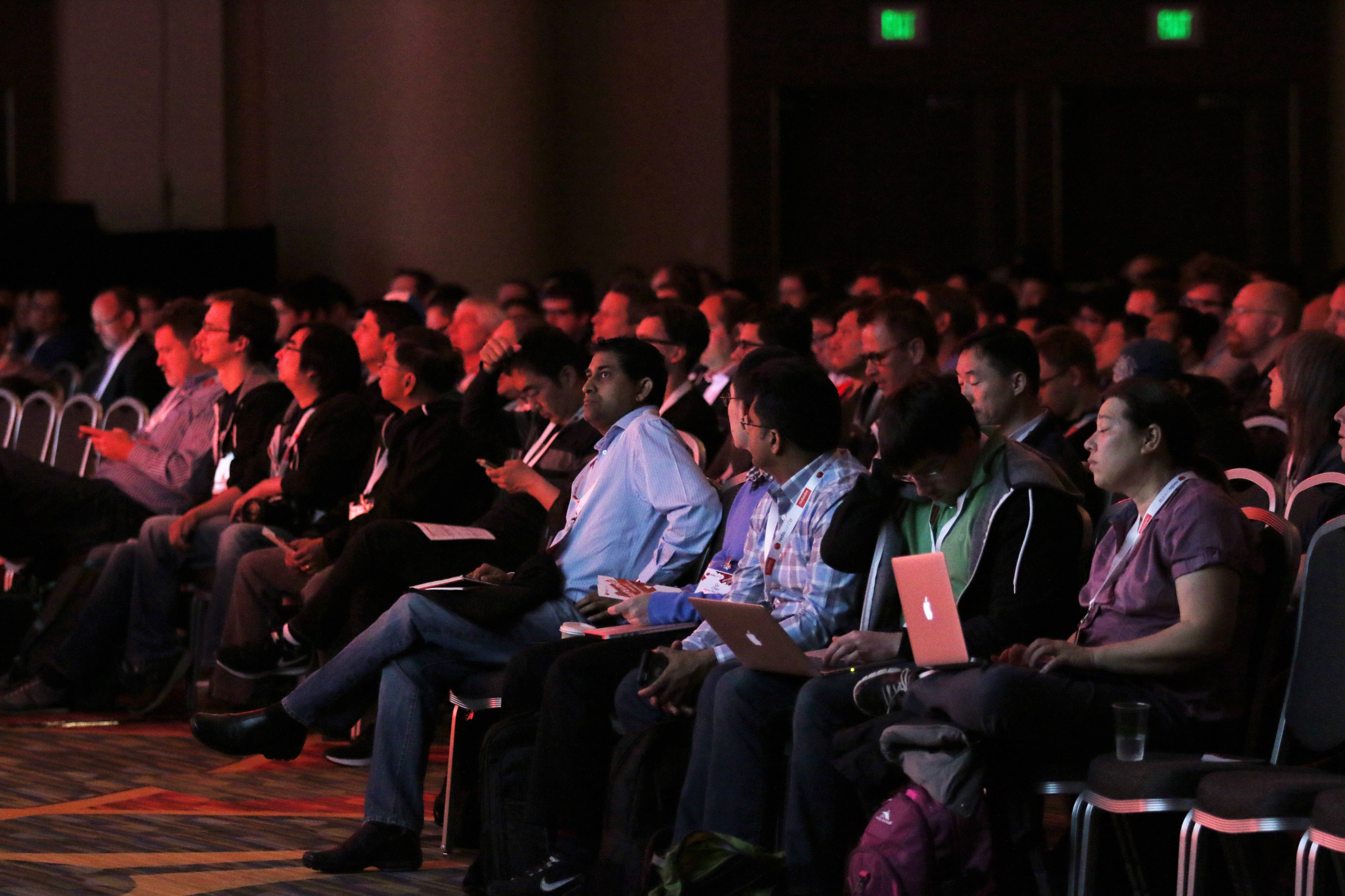 Audience members watch the RedisConf keynotes